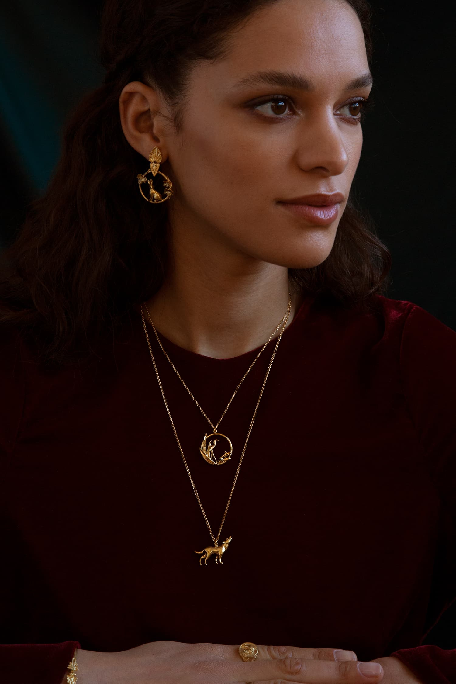 Model wears Fables Wolf and Heron necklace and Hare and Tortoise earrings