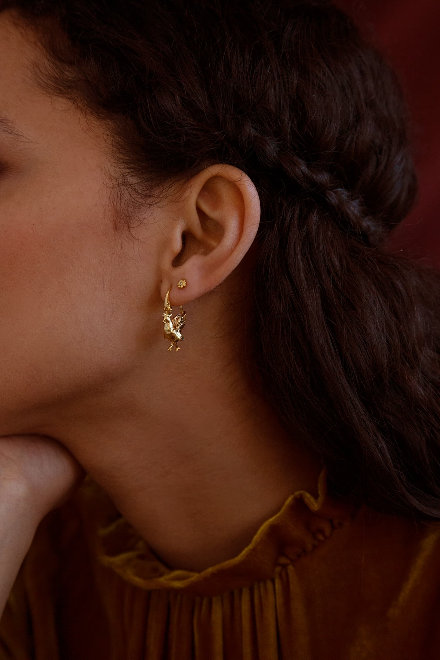 Model wears Fables small Rooster ornate Creole Earrings in gold plate