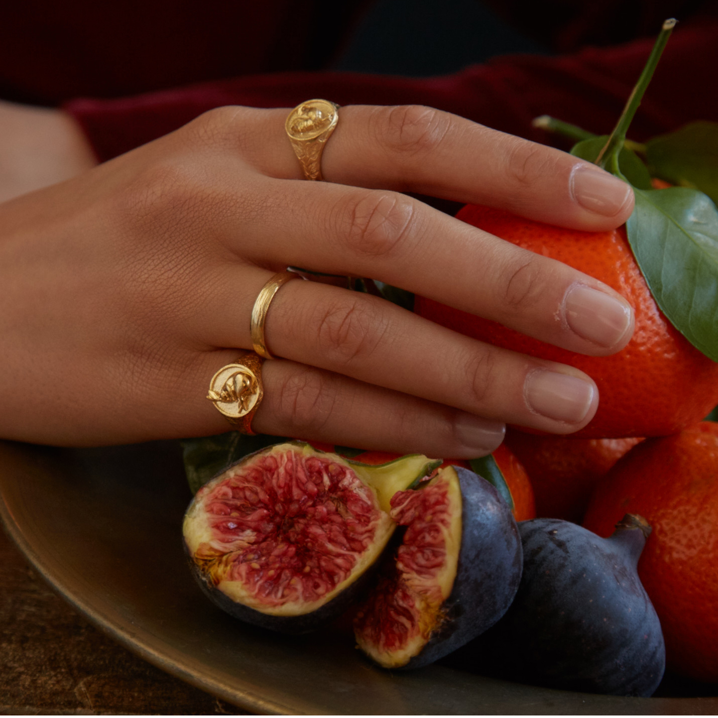 fairmined gold plated sleeping hare and rooster signet rings worn by model