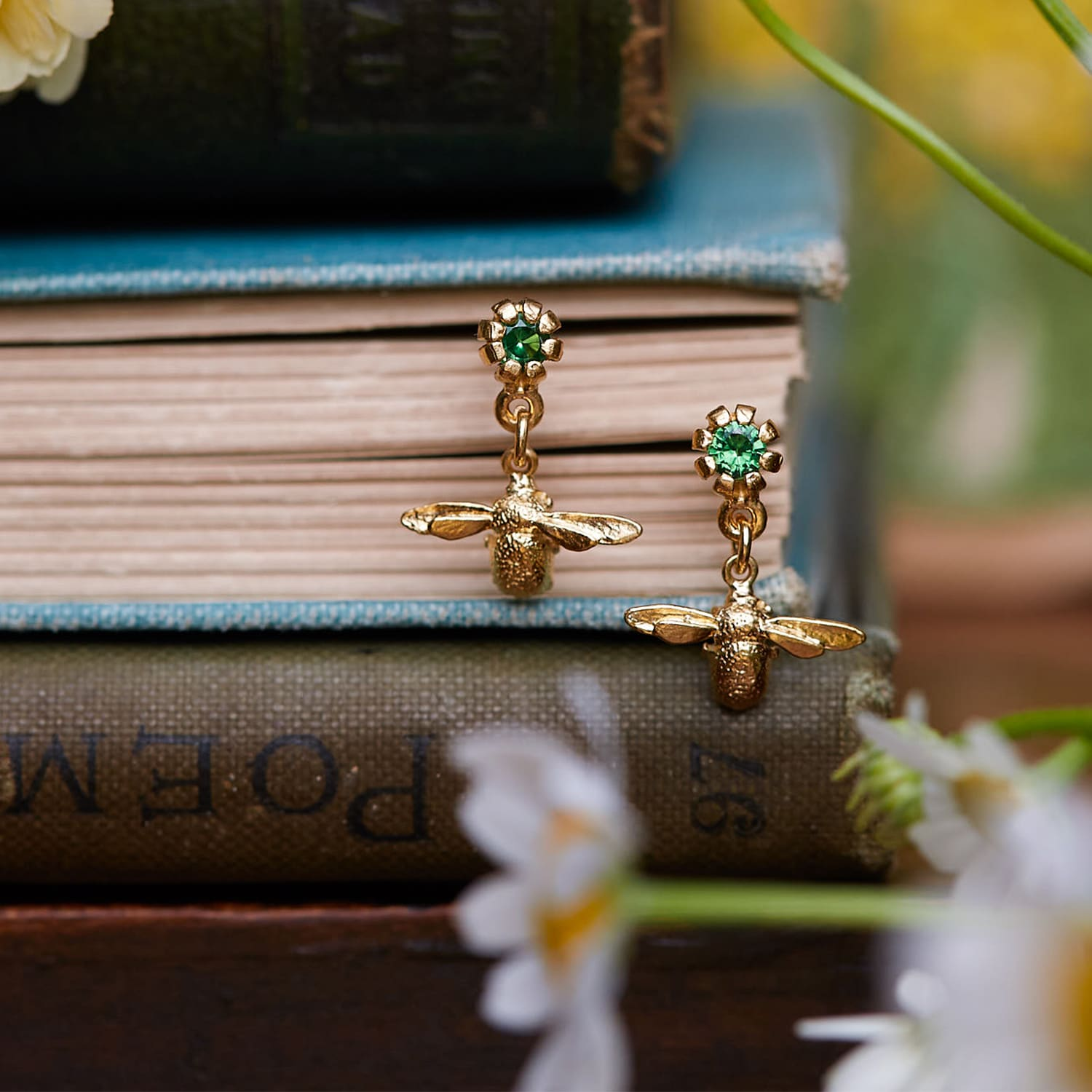 limited edition yellow gold plated bee earrings with radiant green tsavorite gemstones for Earth Day