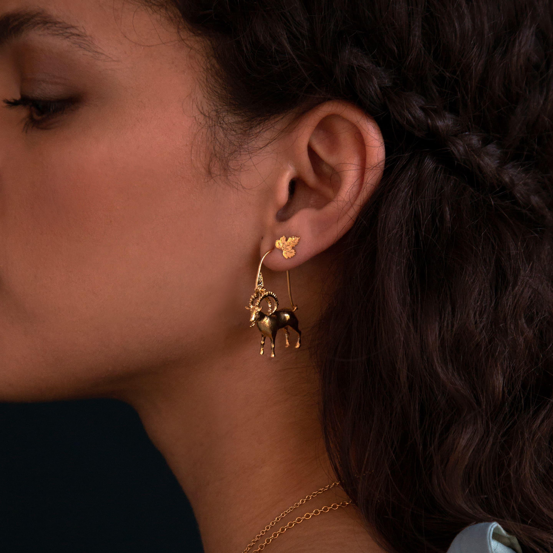 fairmined gold plated ram hook earrings and vine leaf stud earring worn by model