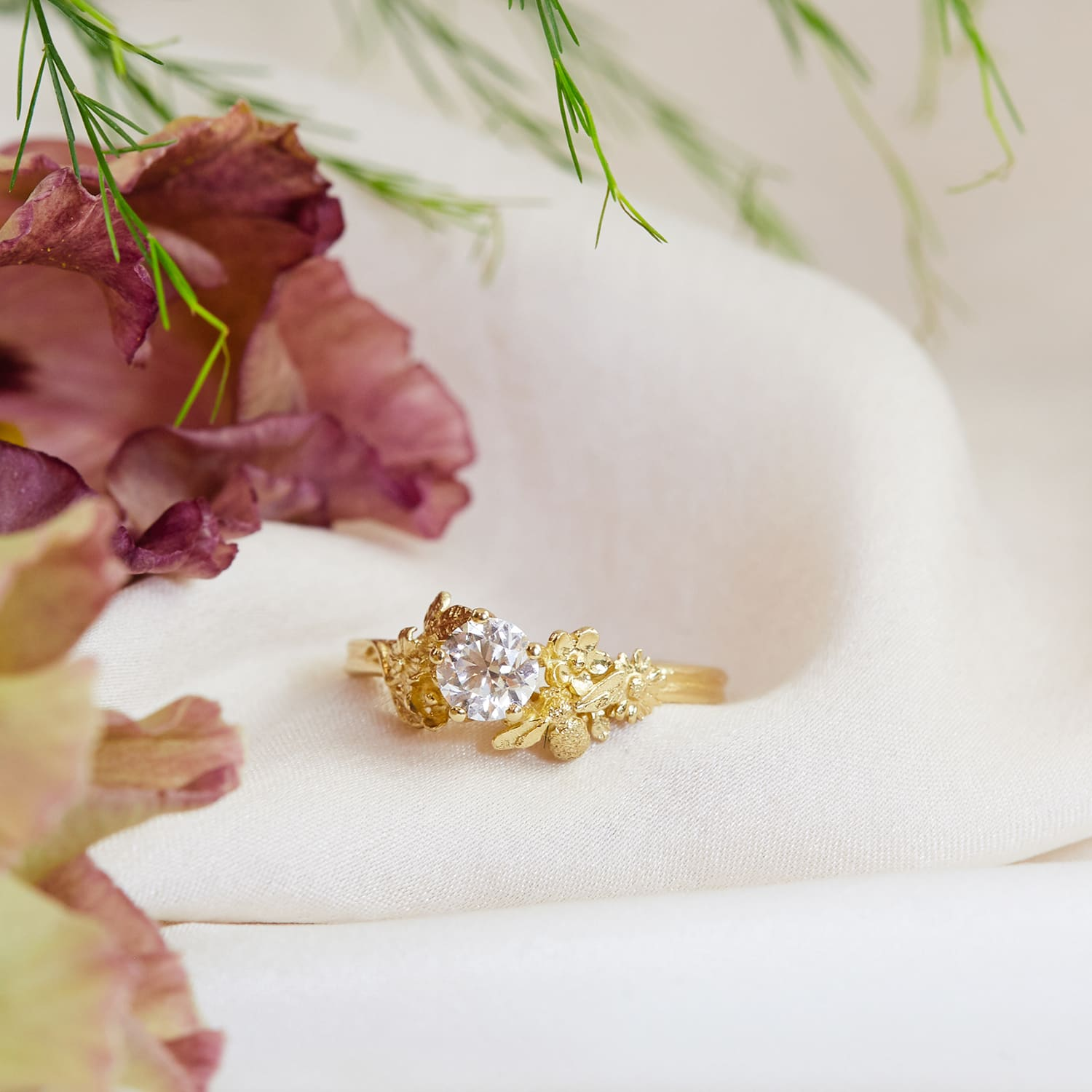 spectacular half carat diamond 18ct yellow gold engagement ring with bee and floral details on silk with flower petals