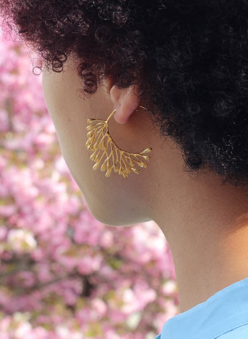 gold plated seed pod large hoop earrings worn by model
